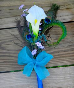 Bridesmaid bouquets! Calla lily peacock bouquet  for bridesmaids, single stem calla lily, purple and teal accent flowers. $18.00, via Etsy.