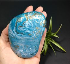A personal favorite from my Etsy shop https://www.etsy.com/listing/506098375/teal-hydro-painted-river-rock-garden