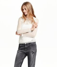 Long-sleeved top with front section and sleeves in embroidered mesh. Back section in airy slub jersey.