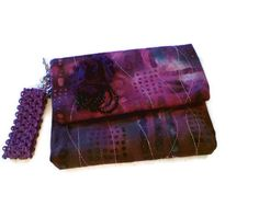 Purple Rain  Batik in Shades of Purple Fushia by tonilovesbuttons  Check out my new line of quilted batik evening bags @tonilovesbuttons.etsy.com