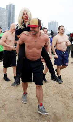 Lady Gaga and Taylor Kinney took the Polar Plunge, and his muscles are definitely the highlight of the event.