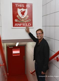 """Liverpool FC on Twitter: """"PHOTO: Jürgen Klopp touches the 'This is Anfield' sign for the first time as #LFC manager http://t.co/r2inHdMO7X"""""""