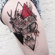 Tattoo on the thigh of the girl - deer, rose and triangles