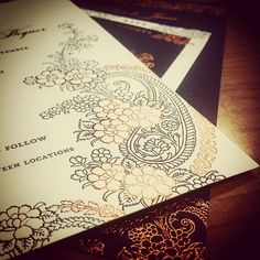 Gajal - a beautiful floral paisley design. This invitation was printed with copper foil and eggplant ink. The schedule of events and menu was printed with copper ink on eggplant paper. Stunning!  #paisleyinvitation #paisley #indianwedding #indianbride #weddinginvitation #menu #invite #wedding #copperfoil