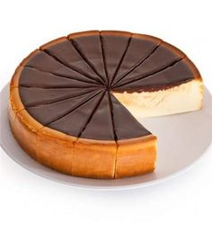 Our New York Cheesecake is delicious all by itself, but we decided to dress it up a bit with delicious, gooey fudge. The top of our creamy, smooth New York Cheesecake is smothered with decadent, rich fudge, making an irresistibly decadent dessert.