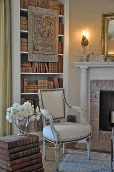 Beautiful Living Room by Brooke Giannetti/   notice all the books have been recovered in the same paper