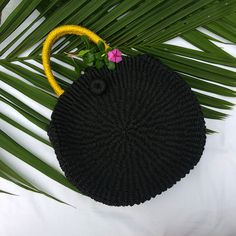 Cierra Bag 🌿🌿 Style: Casual Features: Round tote bag in black with yellow handle Diameter – 13 inches Thickness – 4 inches Handle – 6 inches Sling – 47 inches Unique Bags, Basket Bag, Unique Colors, Handmade Bags, Fair Trade, 6 Inches, Twine, Handicraft, Color Combos