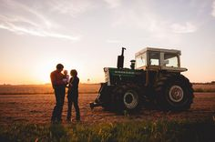 midwestern family photoshoot with a tractor and sunset.  baby couple photo www.photosbycarrie.blogspot.com www.facebook.com/photosbycarriebower