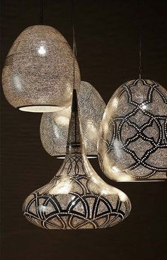 Love these ... Egyptian inspired oversized lamp pendants by Zenza  with intricate perforated designs that create astonishing illusions and shadows in their surroundings when lit