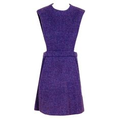 1960's Pierre Cardin Lilac-Purple Wool Space-Age Pinafore Dress via Timeless Vixen.  Love the purple color and the wool twill textile.  A dramatic patterned or solid silk blouse worn underneath would be chic.