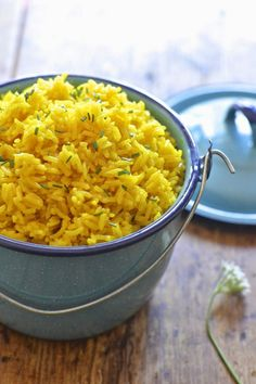 This easy yellow rice is flavored with turmeric and is ready in under 20 minutes. Yellow Rice Recipe Saffron, Recipes With Yellow Rice, Green Rice Recipe, Saffron Rice, Yellow Fried Rice Recipe, Greek Rice Recipe Easy, Yellow Mexican Rice, Indian Yellow Rice, Spanish Yellow Rice Recipe