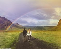 One of the couple's breath-taking snaps was of them standing under a rainbow in a field in the middle of the country
