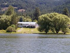 Rare Find: 5 Acs w/ over 250' of water frontage on Comeback Bay..boatable to Lake Pend Oreille. 2 cyclone fenced yards for your pets. 6 Bdrm 4.5 Baths home with 2 complete living quarters. One on the main level & the other in the daylight basement. 2 Large native rock fireplaces.Walk in pantry..Large deck for entertaining. Paved driveway & parking area. 2 garages..one is 30x60 w/4 rollup doors. the second one is 25x36 2 bay plus shop area.