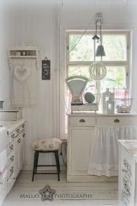 All white kitchen...and a darling skirt on the cabinet.