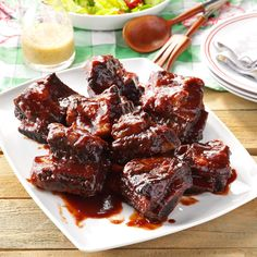 Barbecued Beef Ribs Recipe -These tender, slow-cooked ribs with a tangy sauce are a cinch to make. They're great for picnics and parties. —Erin Glass White Hall, Maryland