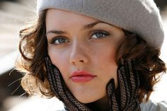 Winter fashion.... Love the curly hair with hat