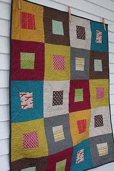 quilt of squares... I like so much use of solid, with just a slash here and there of pattern.