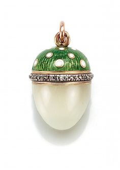 A FABERGÉ GOLD, DIAMOND, ENAMEL AND BOWENITE EGG PENDANT - the top enamelled with white dots on a translucent green ground, rose-cut diamond border, the base of bowenite, with workmaster's initials, 56 standard   by Sotheby's