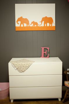 Modern Girl's Nursery  |  caitlin elizabeth photography; gray walls, elephant pack, modern dresser/changing table.