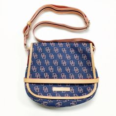 Dooney & Bourke Messenger Bag Cute blue and pink cross-body messenger bag with two compartments in the front. Strap is a pink. About 10in length, 2in wide Dooney & Bourke Bags Crossbody Bags