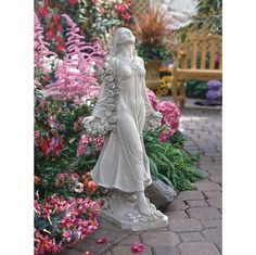 """Flora: """"Goddess of Gardens"""" by Carlo Bronte. The muse of """"all that blossoms,"""" the goddess Flora is especially revered in artist Carlo Bronti's home country of Italy. Sculpted at just over two and a half feet tall, our ethereal beauty is draped in a garland of roses and gossamer fabric that showcases her exquisite splendor, from bare feet to angelic face. Cast in quality designer resin, this statue boasts a rich, antique stone finish."""