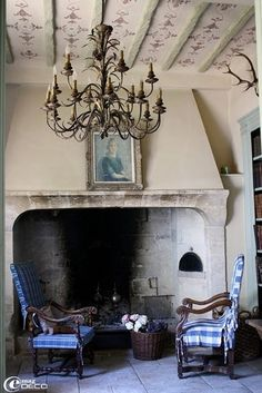 French Country.  Fantastic large stone fireplace could be made into a Halloween fireplace.