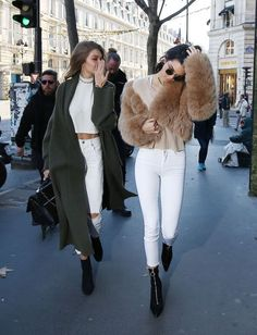 Kendall Jenner and Gigi Hadid were twinning during a recent shopping trip in Paris before the Victoria Secret Fashion Show. The pair donned matching white high waisted pants and cropped tops with black booties with Kendall Jenner finishing off her look with a cropped tan fur coat.