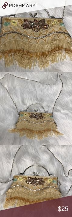 Fringed & jeweled flapper 20s party clutch/purse Such a fun accessory! For dapper days at wdw, roaring 20's Flapper party, or holiday& New Year's Eve Celebration. Its looks to be new made to look vintage. Clasp is nice & tight. My iPhone 7 fits easily. Chain strap is removable. At the top it measures 8 inches across, it gets wider at base. 4 inches high. With fringe detail its 6 inches tall (not including handle) There's a couple stones missing. Chain is 23 inches when on the shoulder. Feel…