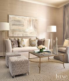 In the formal living room, designer Laurie Pearson paired a custom sofa upholstered in linen from Kravet with two custom ottomans covered in a Lee Jofa fabric.