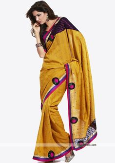 Get simple yet designer look wearing this mustard shade saree. Brocade and embroidered patch work gives it elegant look. It will look good for semi-formal parties. http://goodbells.com/saree/simple-and-sober-mustard-shade-saree.html