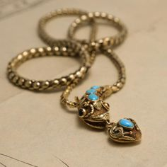15k yellow gold with persian turquoise cabochons, garnet cab eyes heart with locket back 14.5