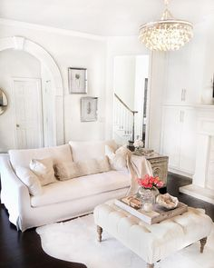 White living room. Farlov sofa. Ikea sofa. Chandelier. Lamps Plus. Glam living room. White paint color