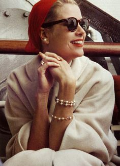 Grace Kelly, bracelets, red beret, pearl earrings, sunglasses, white coat, red lips