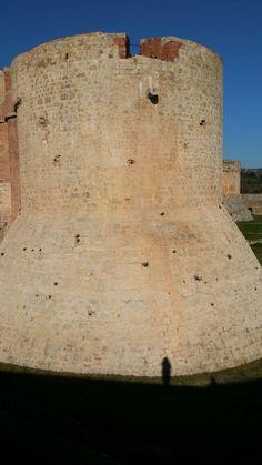 Salses de Fort with human shadow.