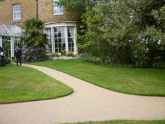 Separate the edge of your lawn from your garden path with EverEdge steel lawn edging.