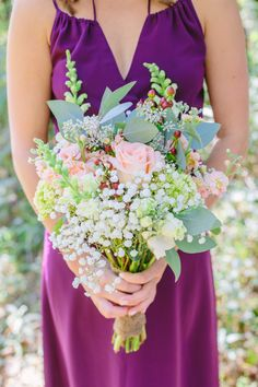 purple bridesmaid dress with white, pink, and pale green bouquet