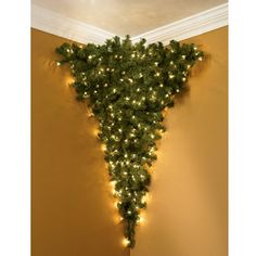 Evoking a 12th century Central European tradition of hanging a tree from the ceiling at Christmas, this unique 4' pre-lit fir attaches to your ceiling.