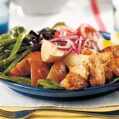 Classic salade Niçoise features tuna alongside potato, green beans, tomato, and olives. Here we've used heart-healthy salmon.
