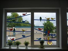 Vogels op het raam