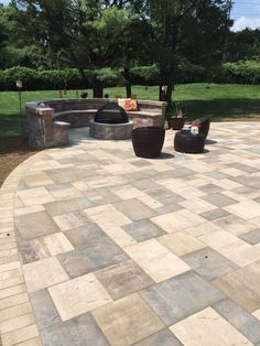 This beautiful outdoor living space was created by Artistic Pavers. It has the perfect little nook for relaxing by the fire with friends and family.