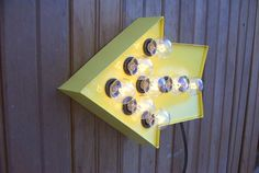 Yellow arrow cinema light. $65.00, via Etsy.