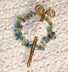 Looking for jewelry project inspiration? Check out Easy  Beaded Shawl Pin by member Lenas Legacy.