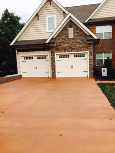 Two year old concrete driveway sealed and stained with LastiSeal® Concrete Stain & Sealer - Cordova Tan