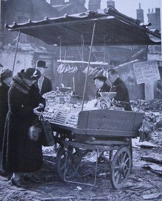 "London during the Blitz, note the sign: ""Hitlers bombs can't beat us. Our oranges came through Mussos lake"". (Mussos lake being short for Mussolini's lake, the Mediterranean sea.)"