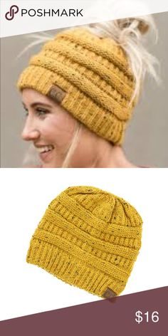 Mustard CC messy bun beanie This is a brand new cc beanie it is mustard confetti with hole in top for messy bun or ponytail cc beanie Accessories Hats