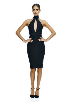 Defining sexy elegance, this wardrobe must, features a halter neckline and vertical slit at the centre of the bodice.