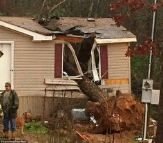 A tree was blown over and onto a house in Atkins, Arkansas, killing an 18-year-old woman and trapping her one-year-old sister inside DEC 23 2015