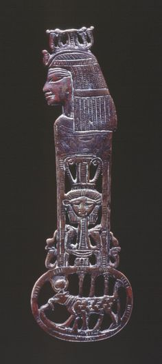 Amulet 18th Dynasty 1390BC-1352BC (circa) Bronze menat-counterpoise amulet: this fine openwork amulet with details incised on both faces depicts the goddess Hathor in three separate manifastations.At the top she is in human form wearing  a Crown composed of upreared cobras.On one face the throne name of King Amenhotep III(Nebmaatre) is written in a cartouche just below her wig.