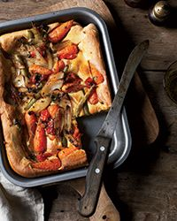 This vegetable-loaded Yorkshire pudding gets flavor from tomatoes, green beans and fresh herbs. Get the recipe from Food & Wine.