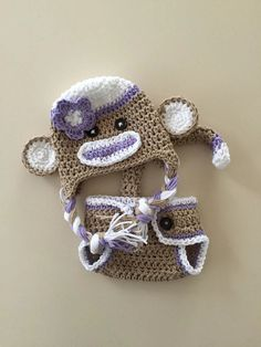 Purple sock monkey hat, diaper cover, newborn photo prop, halloween costume, purple sock monkey hat and diaper cover, baby sock monkey hat Size: Newborn (0-3 months or 13 head circumference), 3-6 months and 6-12 months. Colors: Tan, purple and white Yarn: Cotton This set is made to